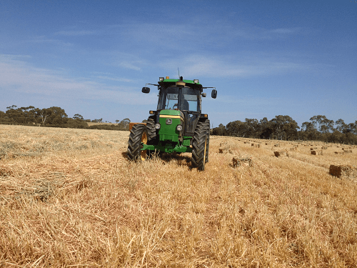 Greg baling early morning for optimum moisture levels - Harvey Hay Sales covering Hartley / Strathalbyn / Fleurieu / Adelaide Hills / Fleurieu & Murray Mallee